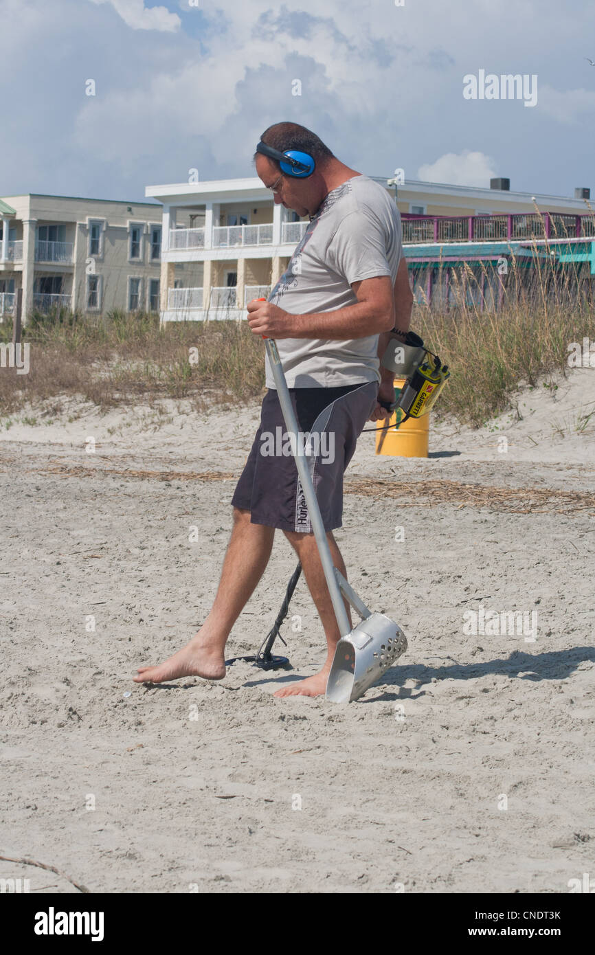Jew Detector: Man Hunts For Treasure With Metal Detector On Beach At