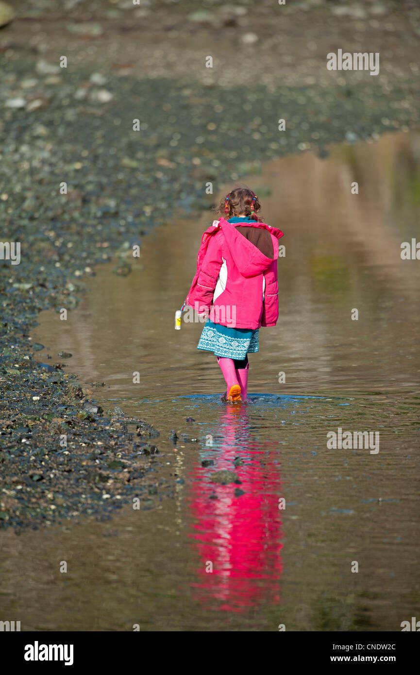 Young girl in pink walking by the sea shore.  SCO 8132 - Stock Image