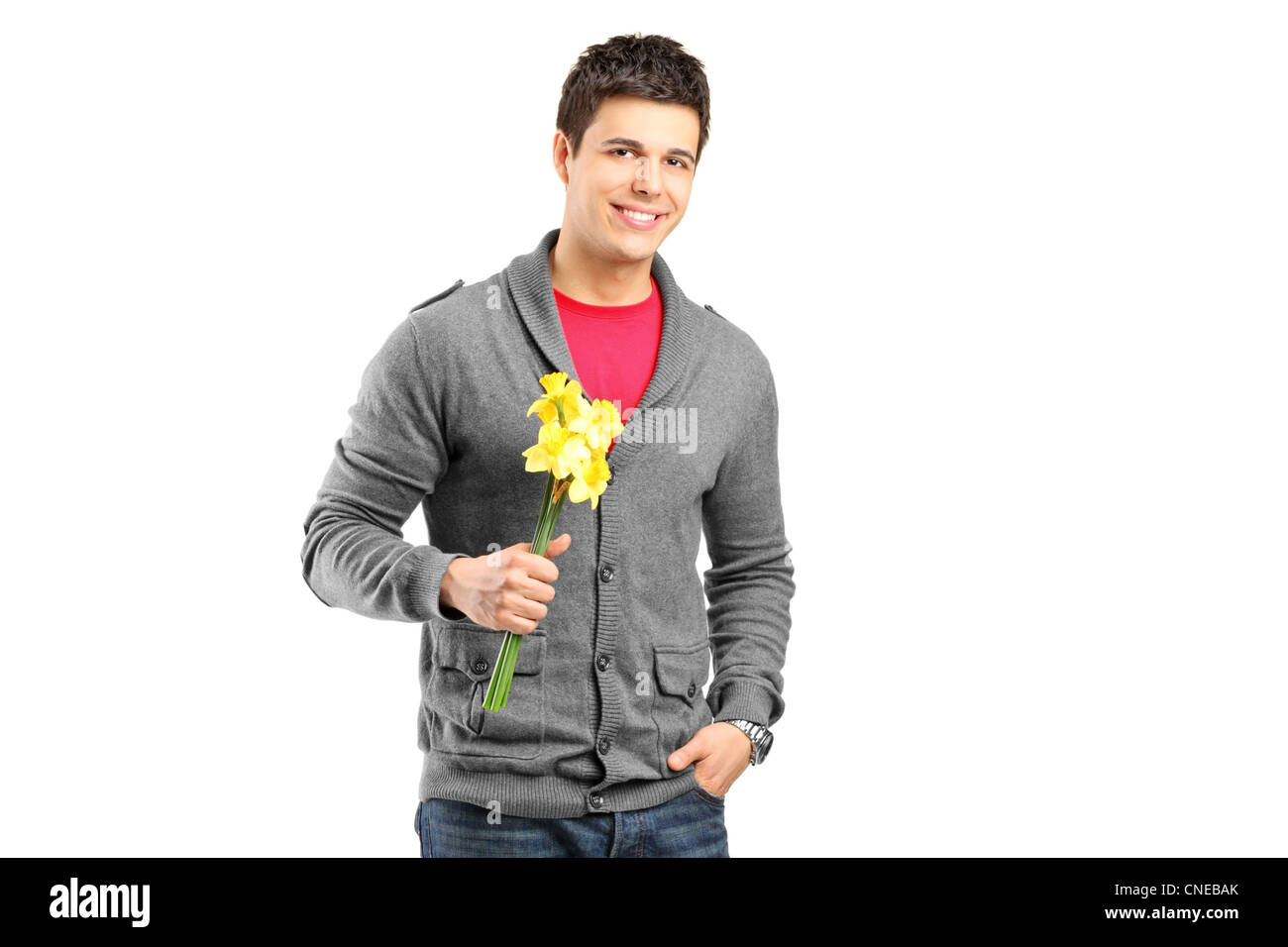 Portrait of a smiling male holding flowers and waiting for somebody to come isolated on white background - Stock Image