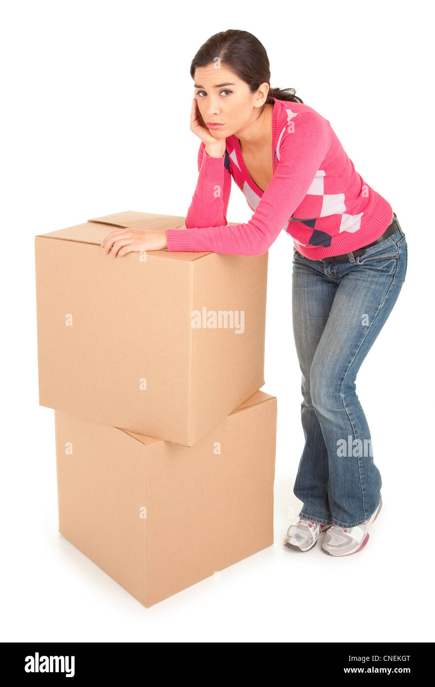A tired looking woman is leaning on cardboard boxes. Stock Photo