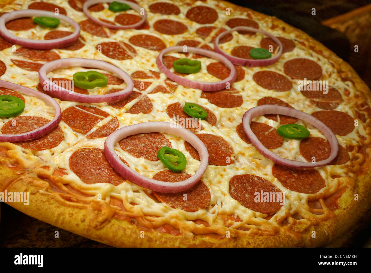 Pizza, displayed for sale - Stock Image