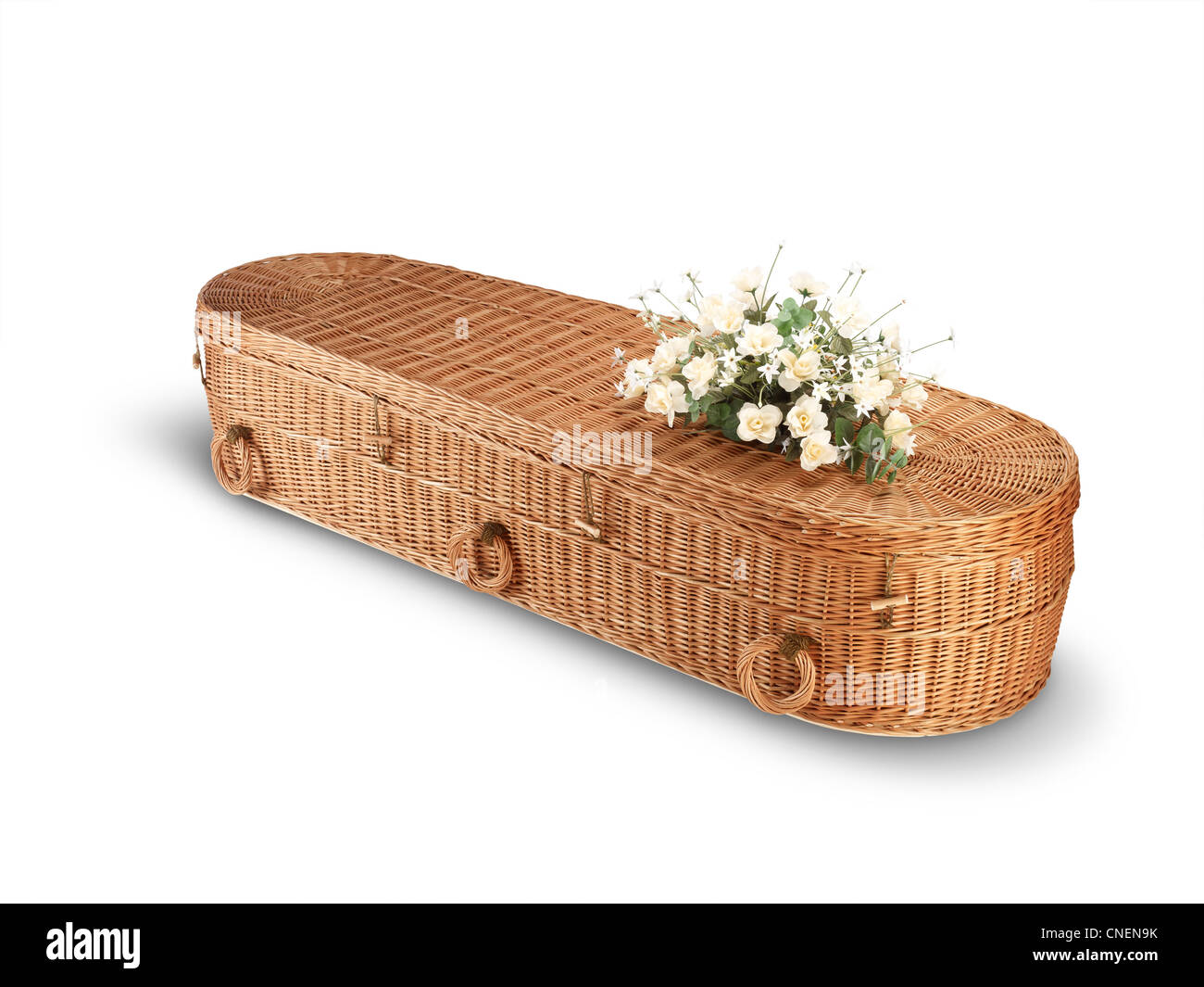 a wicker bio-degradable eco coffin isolated on white with clipping path - Stock Image