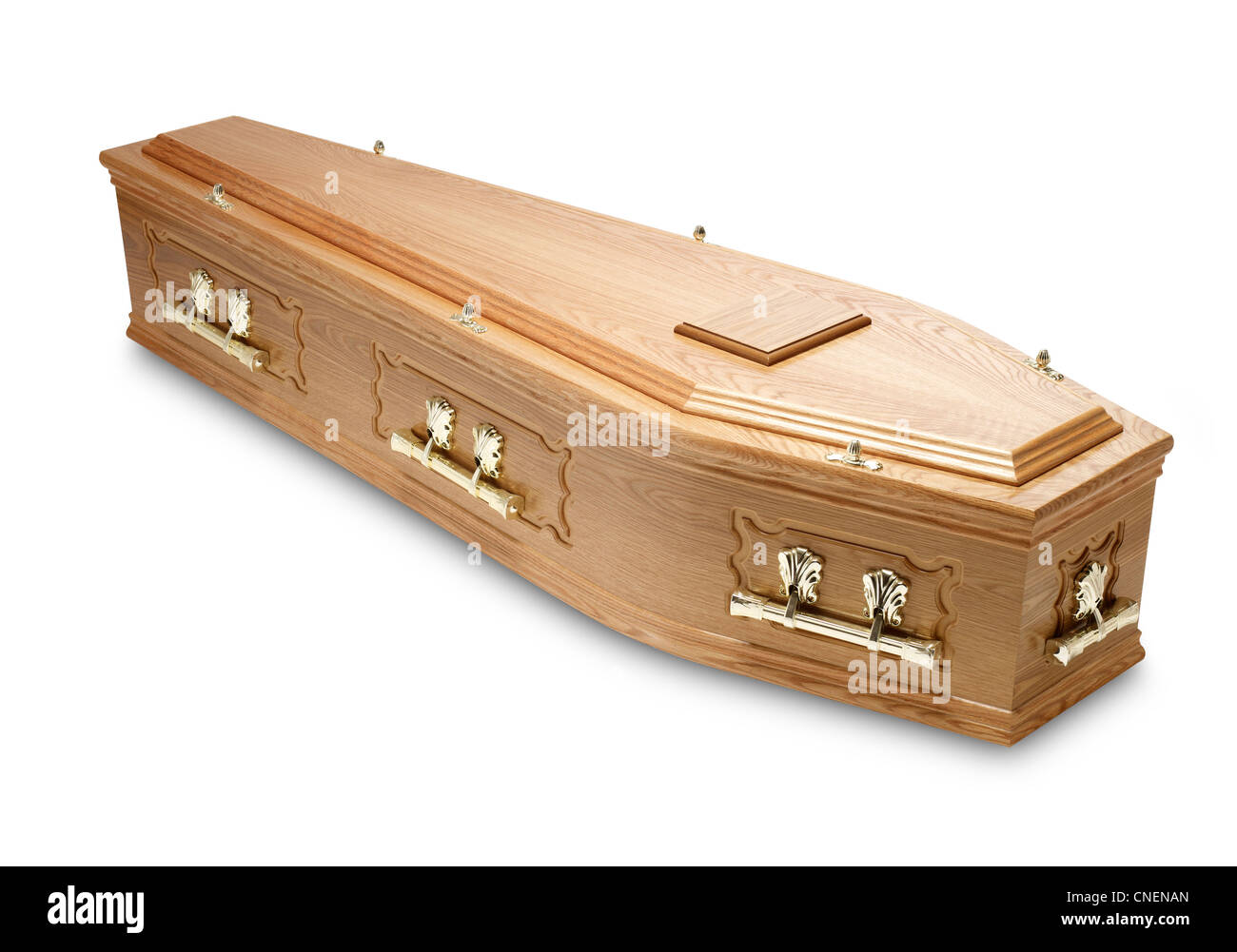 an ornate mahogany coffin casket with brass handles and name plaque - Stock Image