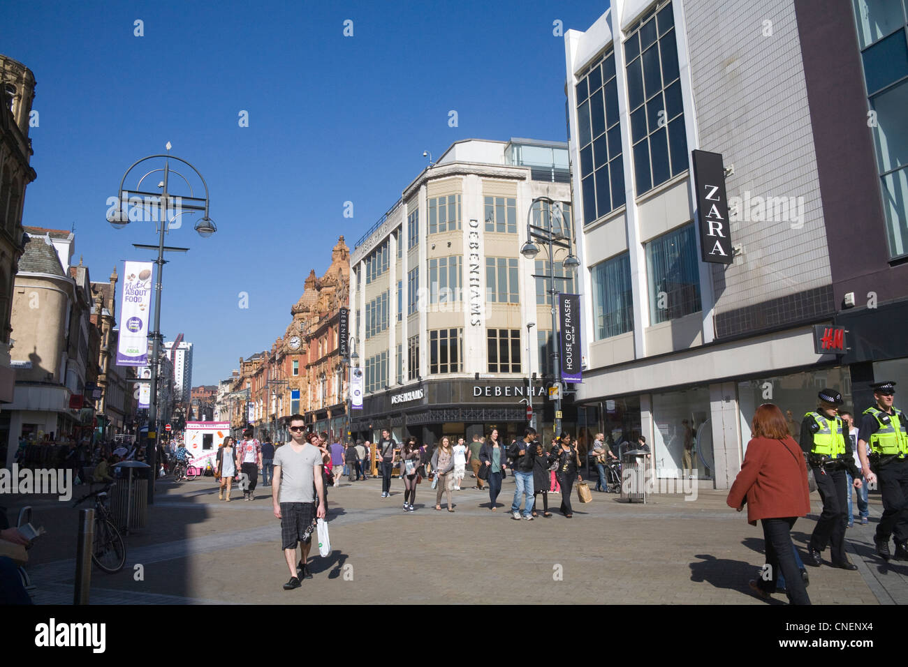 Leeds West Yorkshire England Looking along Briggate a busy city centre shopping street - Stock Image