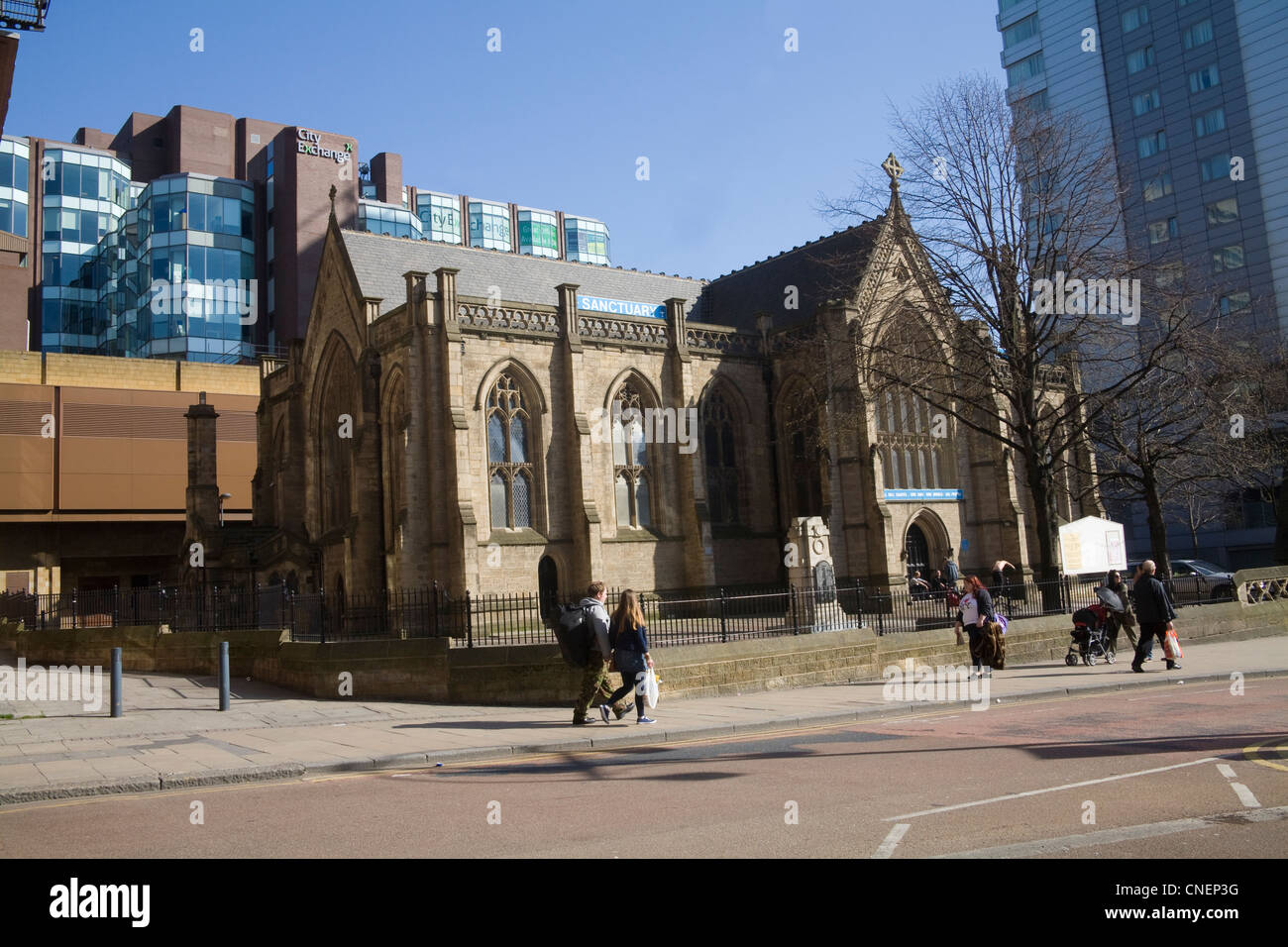 Leeds West Yorkshire England Mill Hill Unitarian Chapel in City Square surrounded by old and new buildings - Stock Image