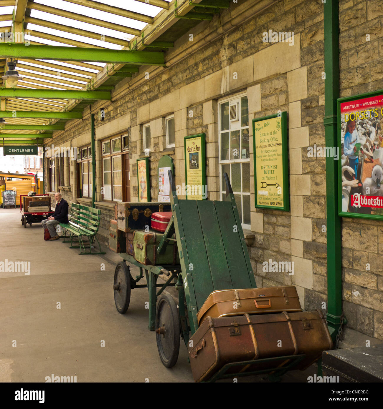 Platform At Swanage Railway Station In Dorset Showing Vintage Fittings And Porters Trolley With Period Luggage Cases
