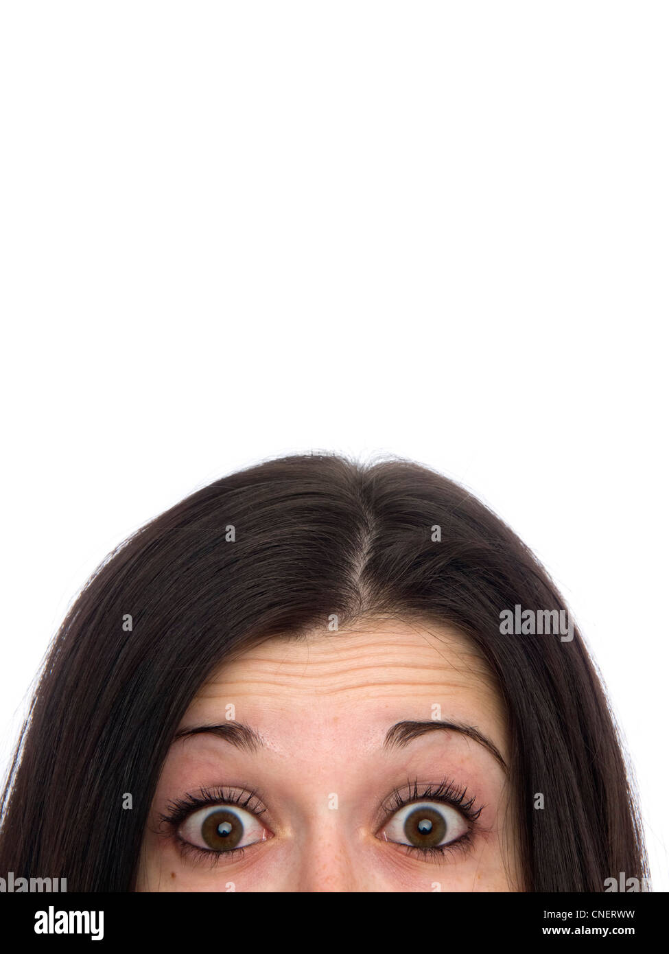 Close up portrait of young woman with surprised look - Stock Image