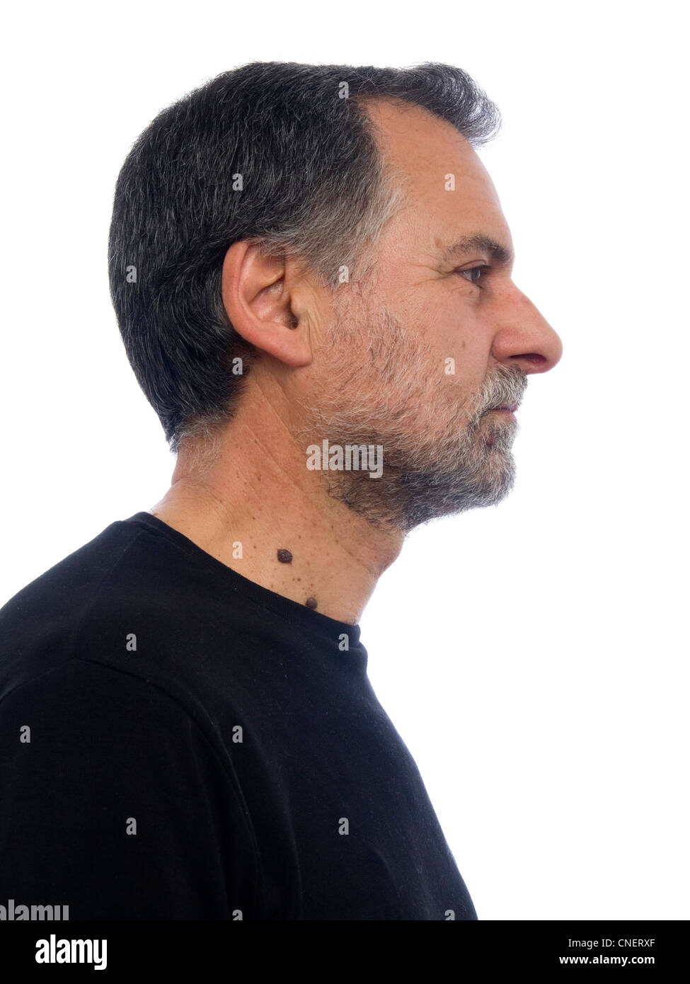 Profile portrait of a bearded middle-aged man - Stock Image