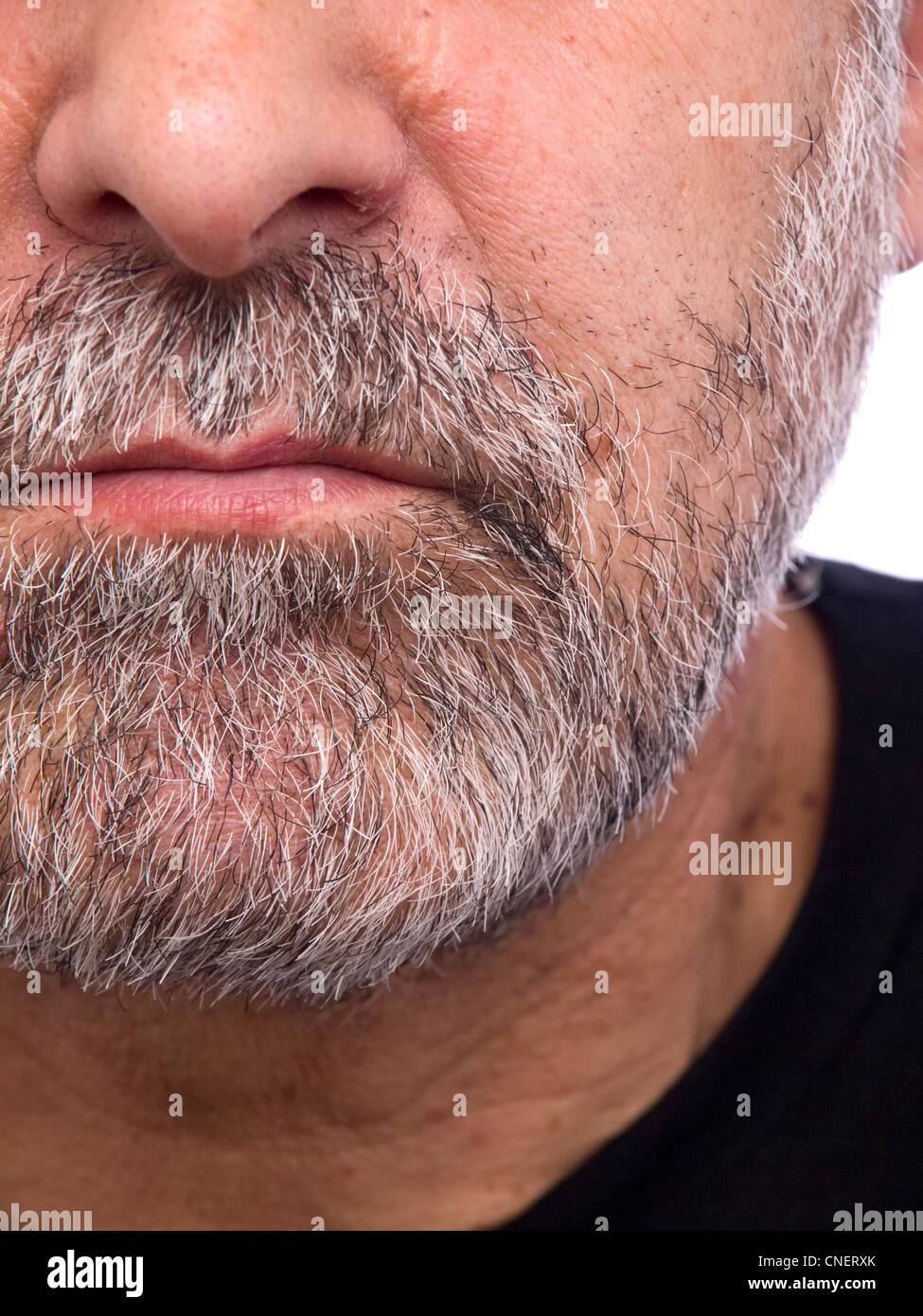 Extreme close up portrait of a serious looking man - Stock Image