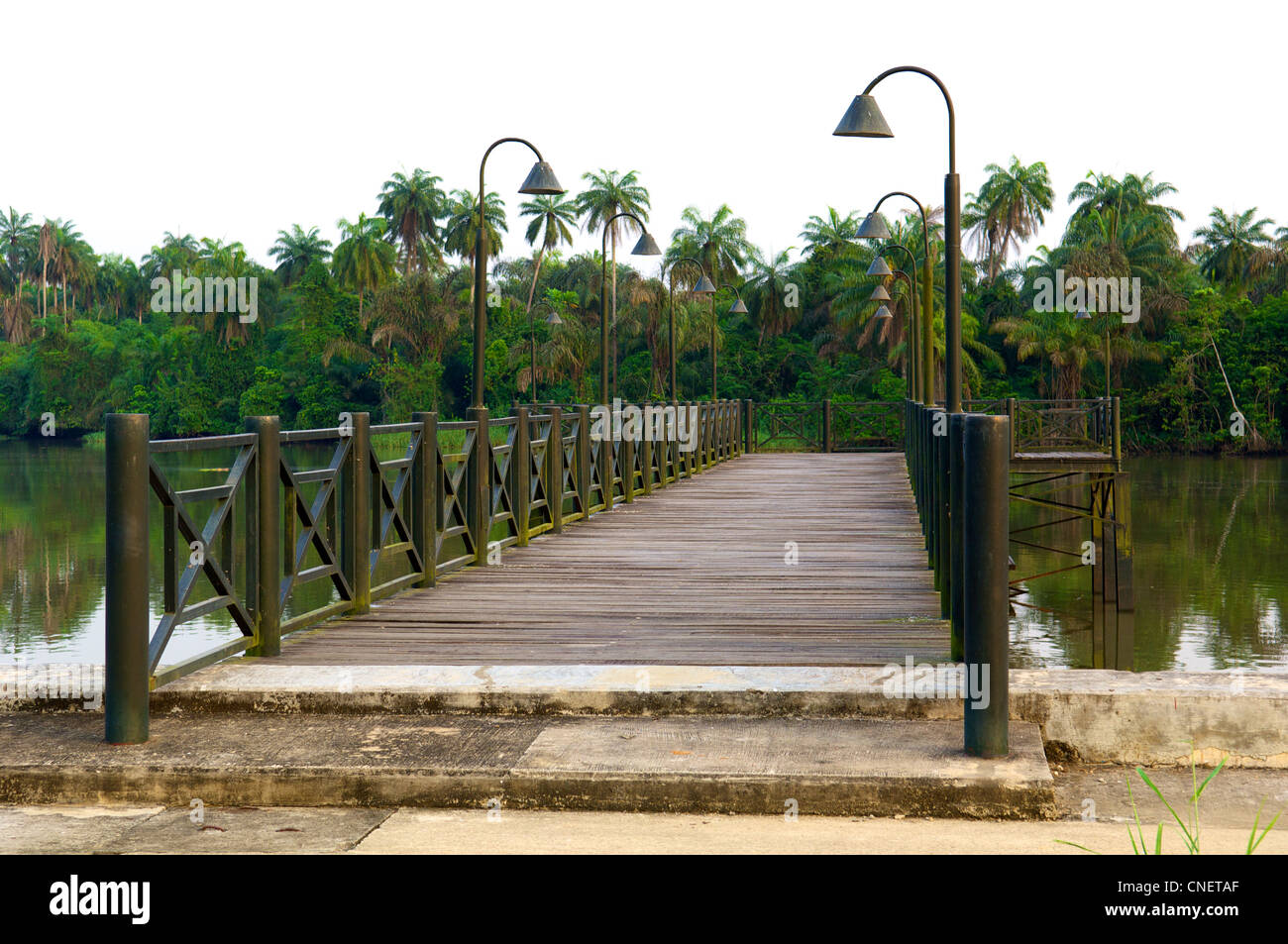 Wooden bridge at River Duem in the oil-rich Niger Delta in Nigeria. - Stock Image