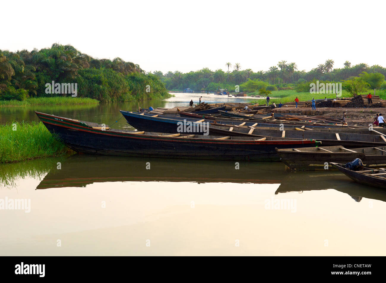 Boats on River Duem in the oil-rich Niger Delta in Nigeria - Stock Image