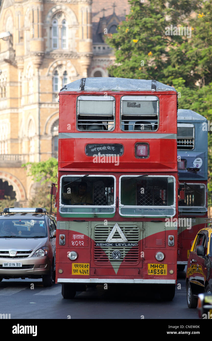 India, Mumbai, Ubiquitous Ashok Leyland red bus, near the Victoria Railway terminus. - Stock Image