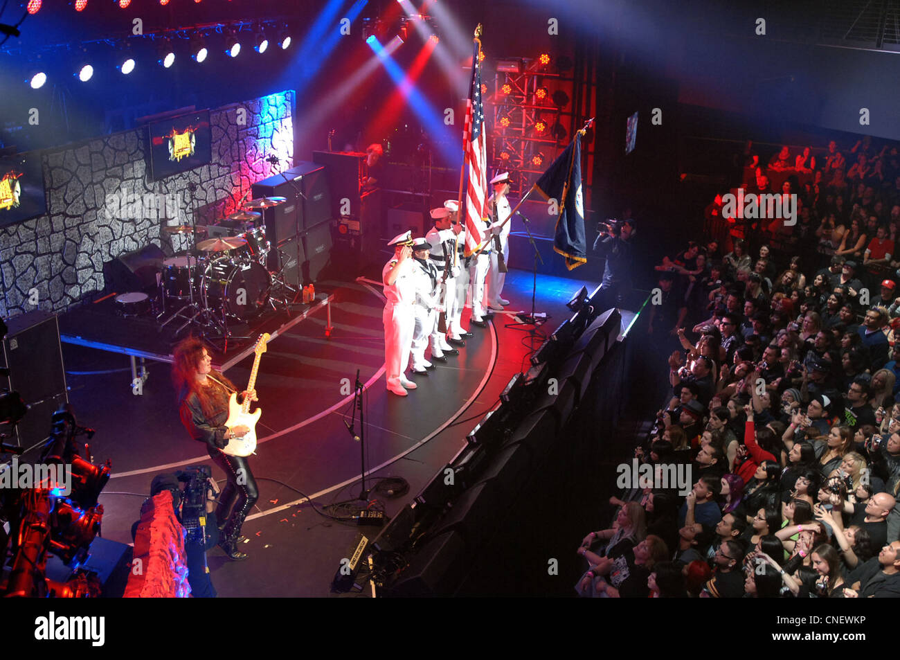 Sailors assigned to Fleet Combat Camera Group Pacific present the colors as world-renowned guitar player Yngwie - Stock Image