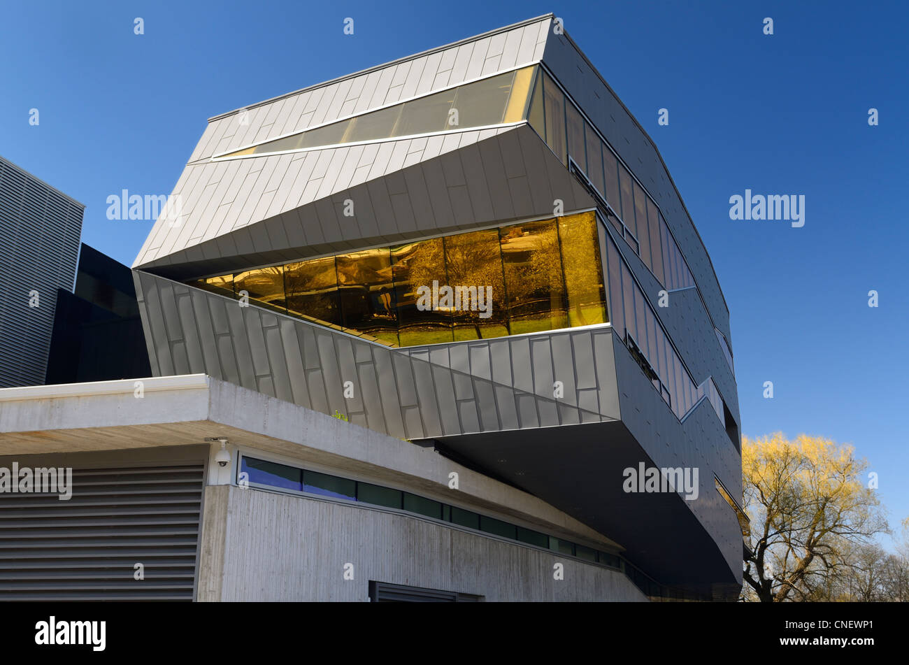 Futuristic architecture of the Perimeter Institute theoretical physics research building reflecting the historic - Stock Image