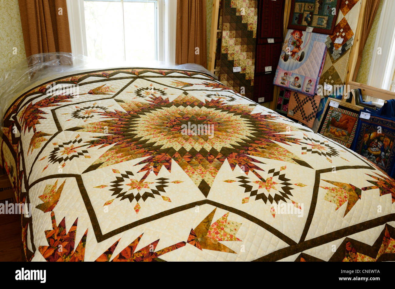 Handmade quilt in the bedroom of a Mennonite home near St Jacobs Ontario - Stock Image