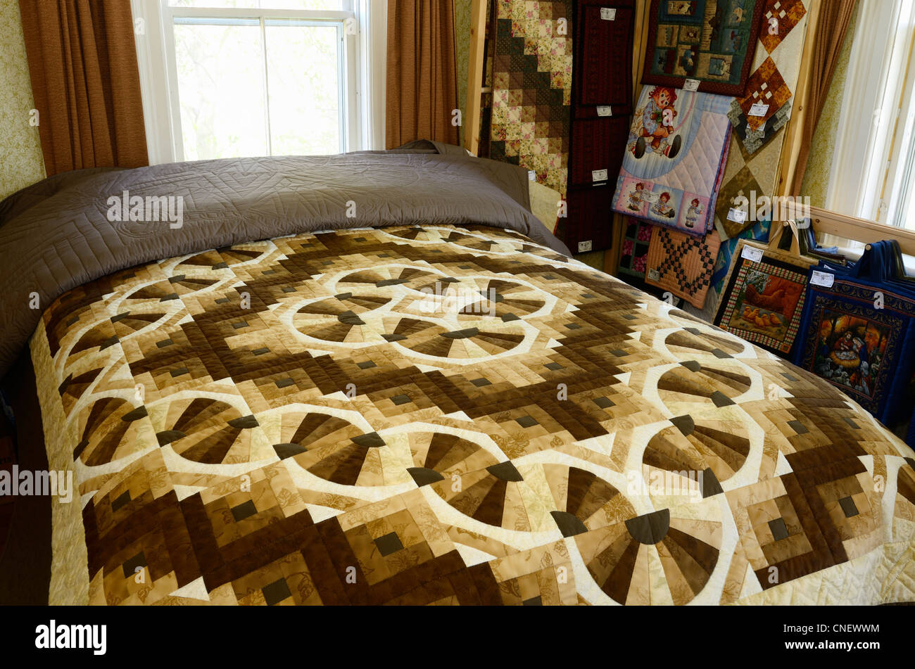 Handmade quilt bed cover in the home of a Mennonite craftswoman near St Jacobs Ontario - Stock Image
