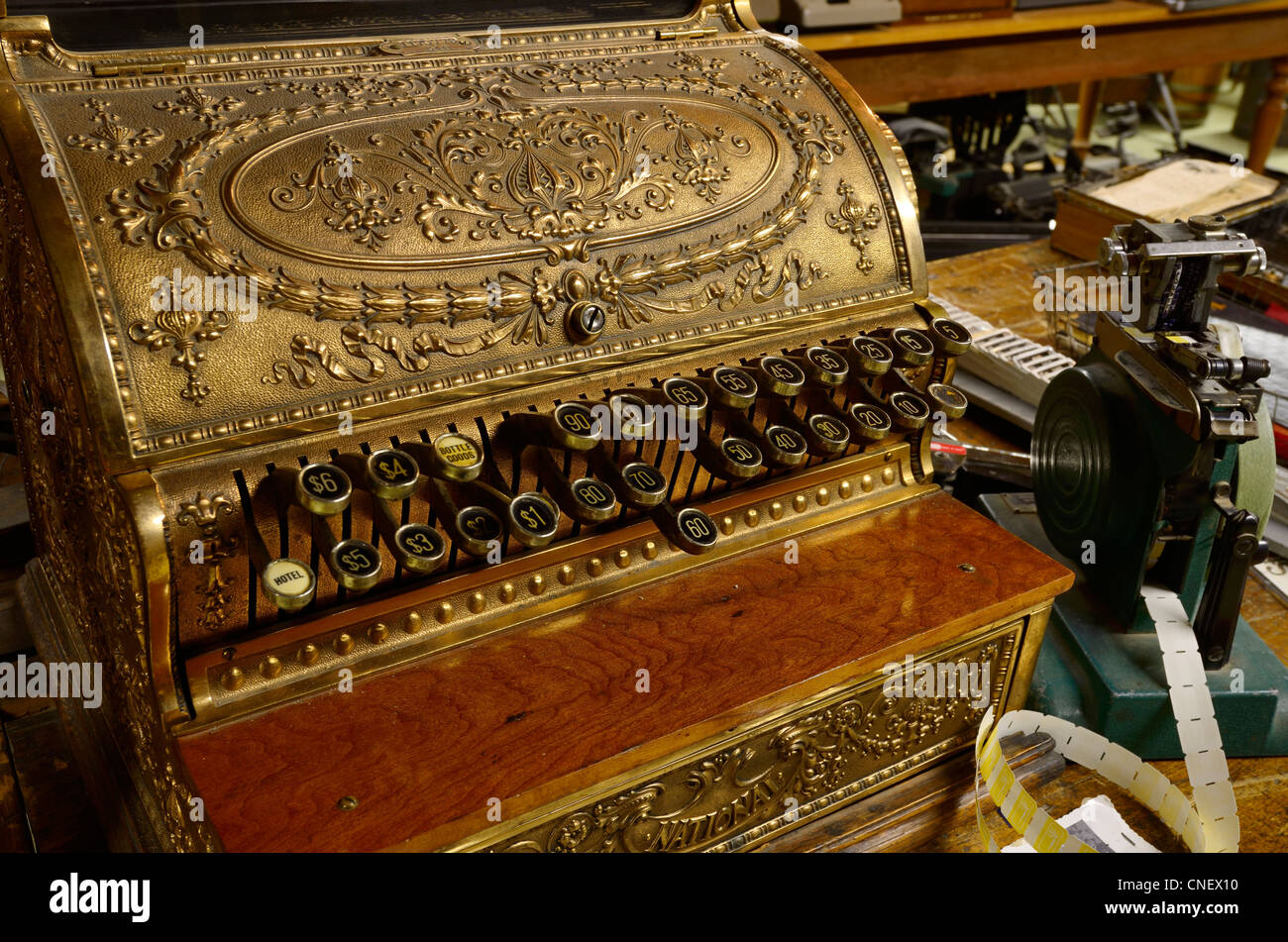 Brass embossed cash register in Home Hardware museum at The Mill in St Jacobs Ontario - Stock Image