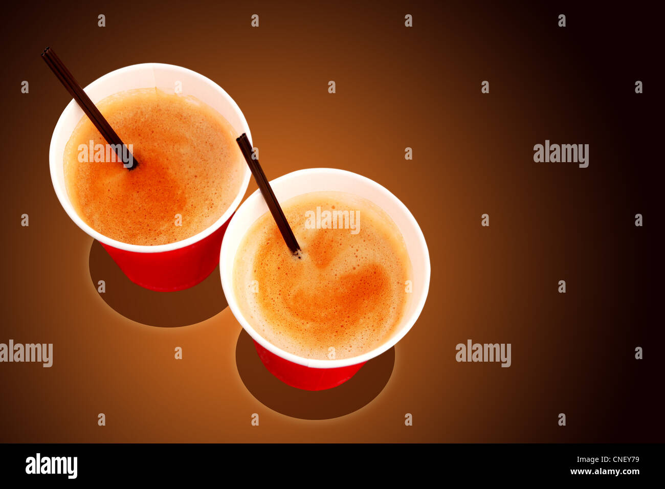 Two paper coffee cups filled with freshly brewed coffee served at a cafe Stock Photo