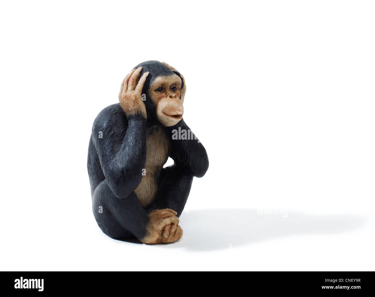 Studio shot of a toy Monkey that heasr no evil - Stock Image