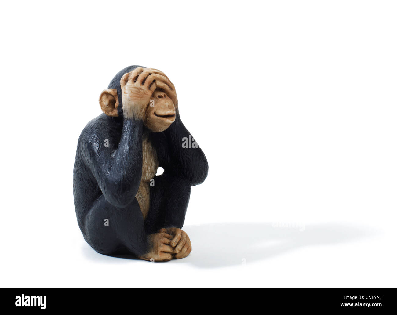 Studio shot of a toy Monkey that sees no evil - Stock Image