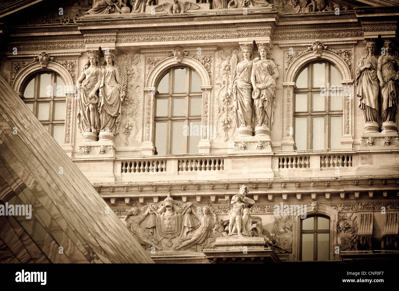 Louvre Palace and Pyramid detail, Louvre Museum, Paris, France - Stock Image