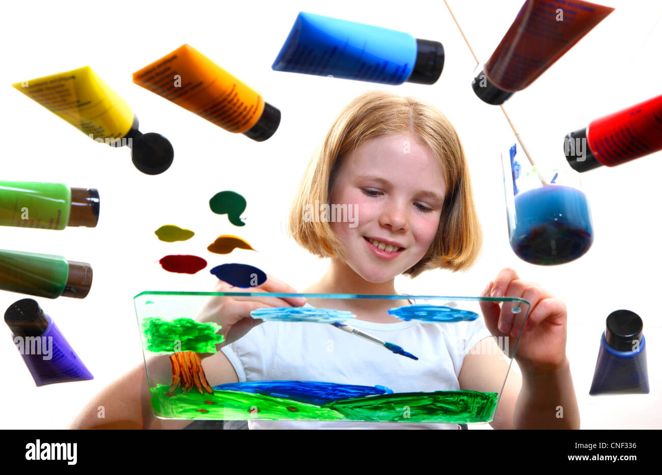Young girl is painting a picture with Acrylic colors. - Stock Image