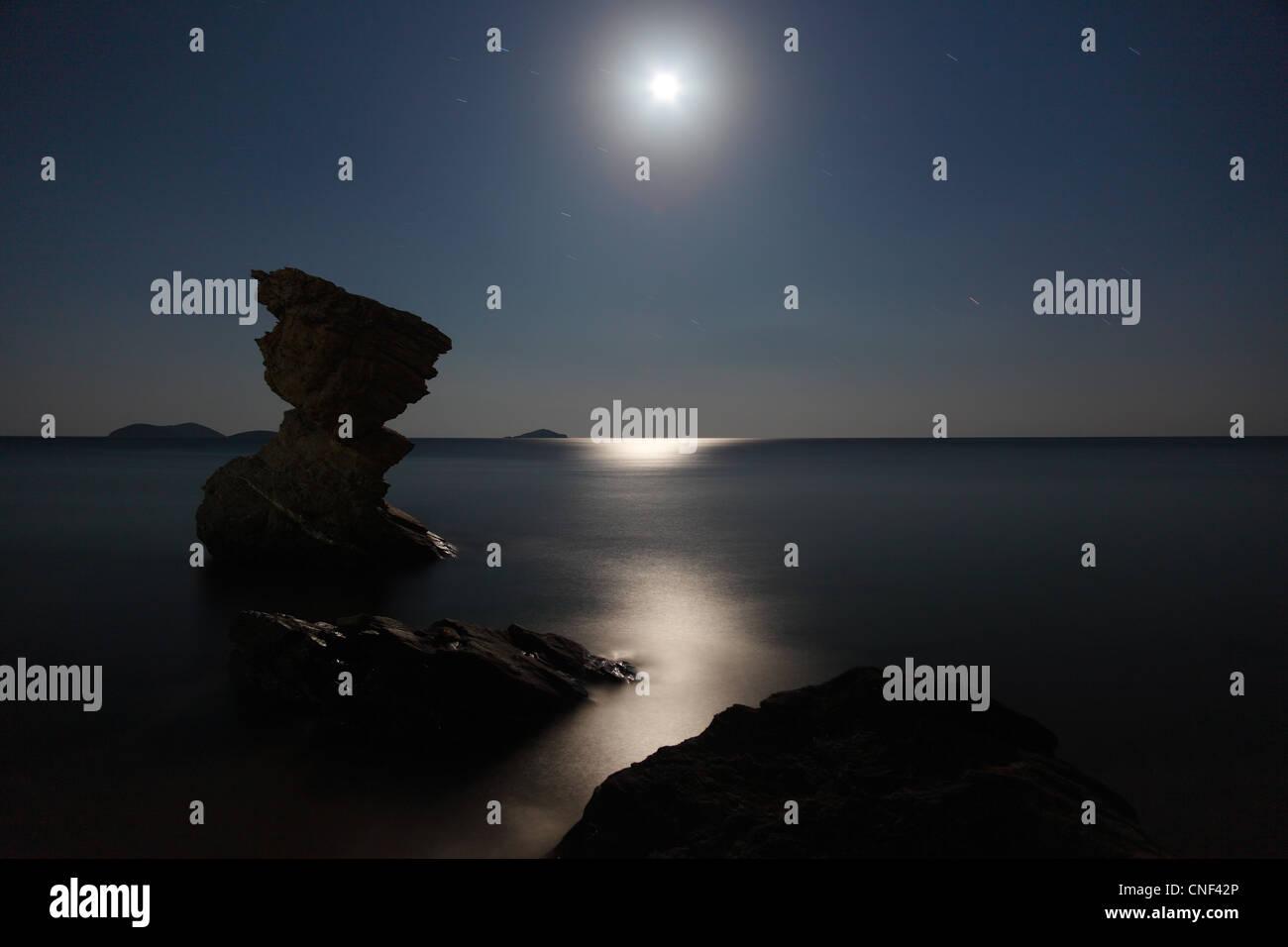 Aegean under moonlight at Andros island, Greece - Stock Image