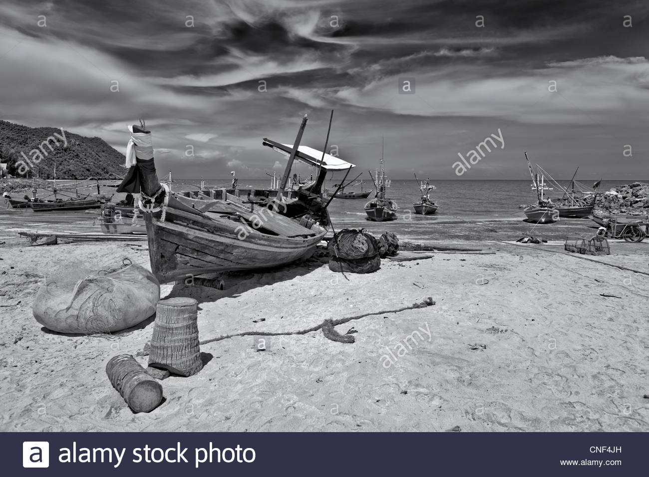 Dramatic skies overhanging a Thailand fishing port. S.E. Asia Black and white photography - Stock Image