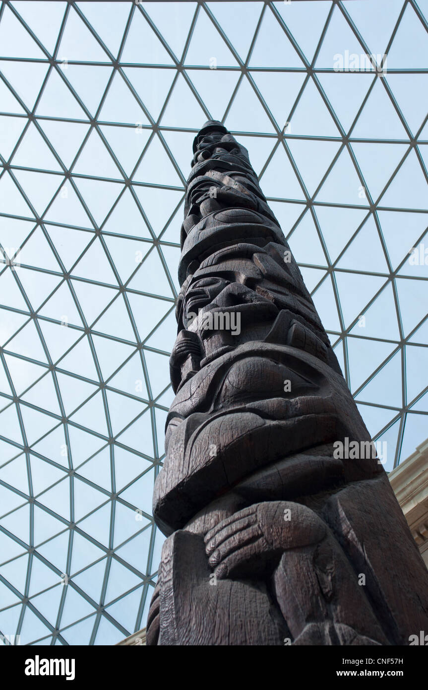 Haida Totem Pole inside the Great Court at the British Museum in London. UK - Stock Image