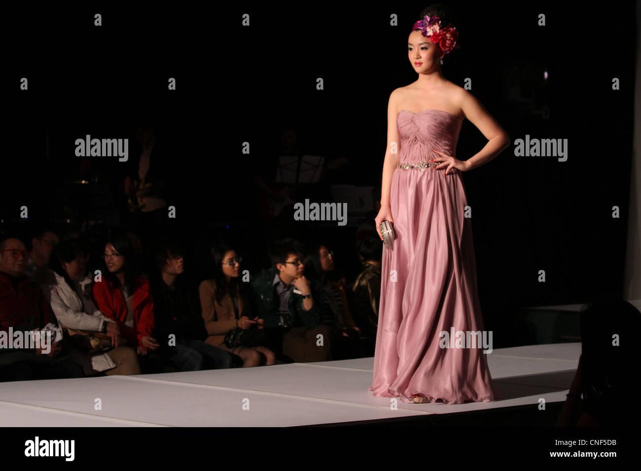 chinese fashion show runway female model catwalk - Stock Image