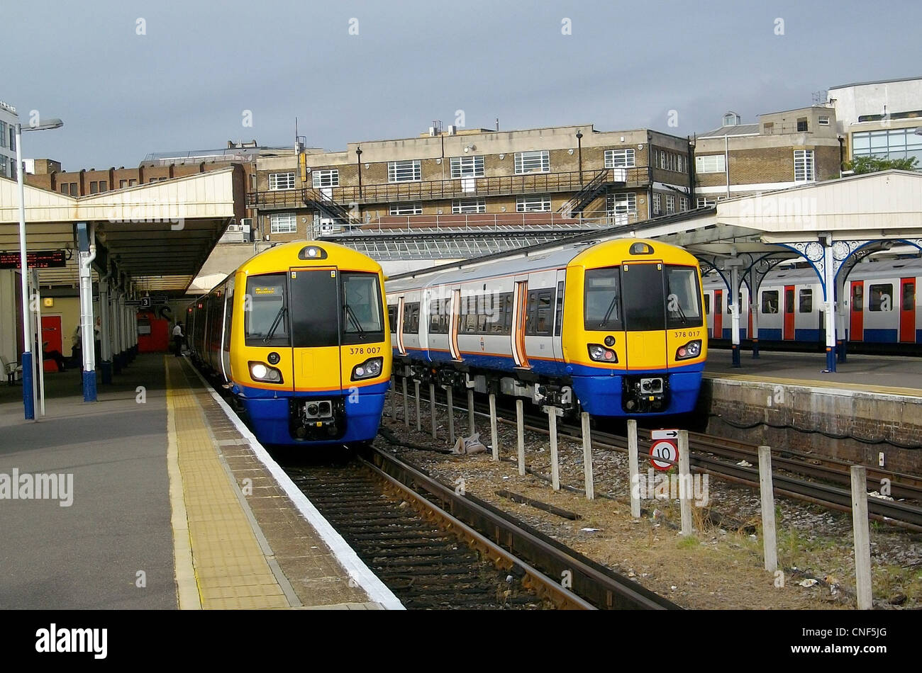 A pair of brand new London Overground Bombardier Class 378/0 Capitalstar EMUs No. 378007 and 378017, stand side - Stock Image