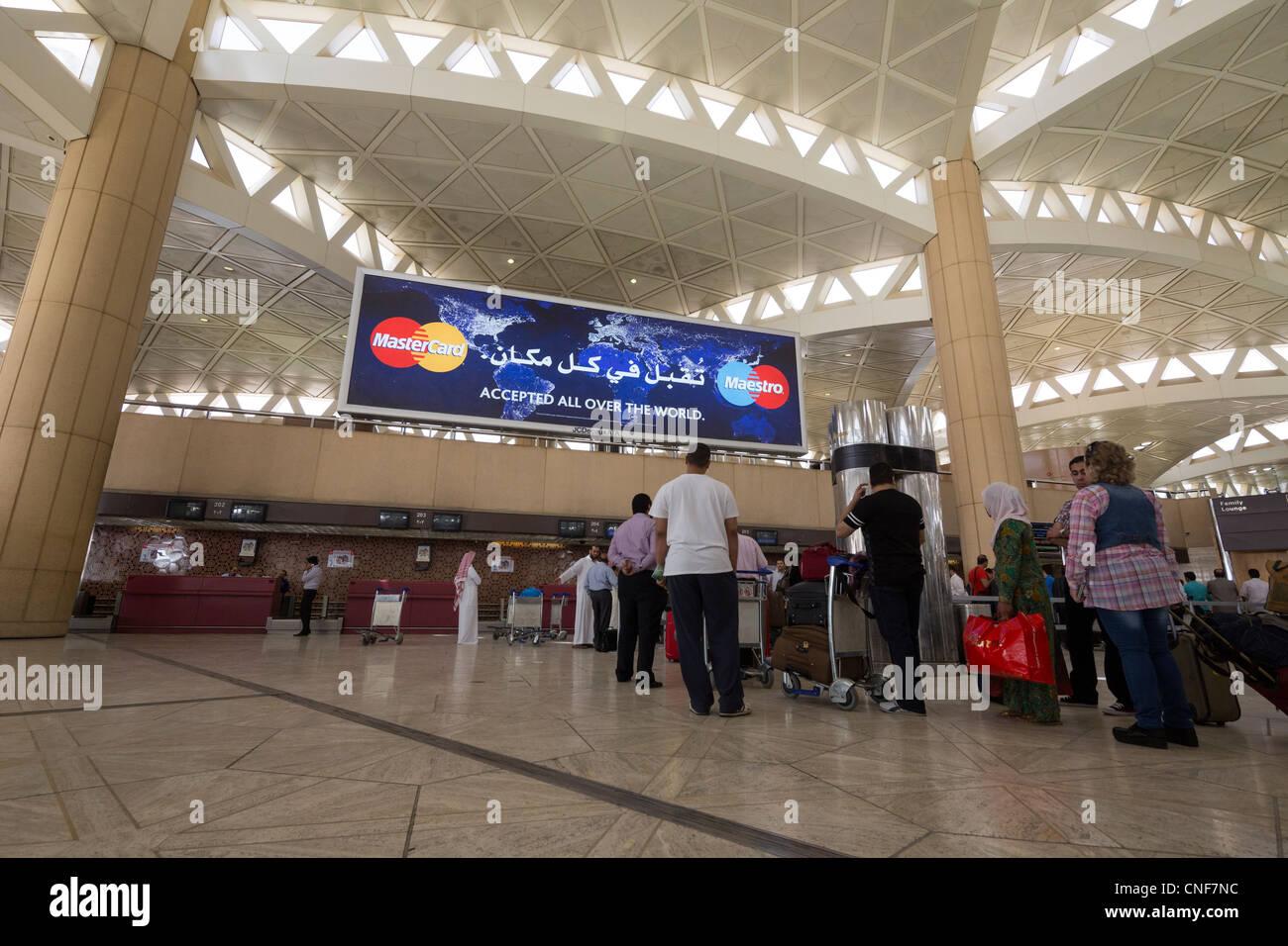 passengers checking in at Terminal 2, King Khalid International Airport, Riyadh, Saudi Arabia - Stock Image