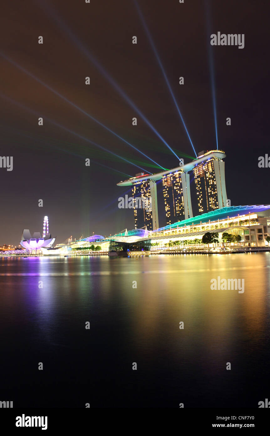 Laser light show over Marina Bay Sands complex in Singapore. - Stock Image