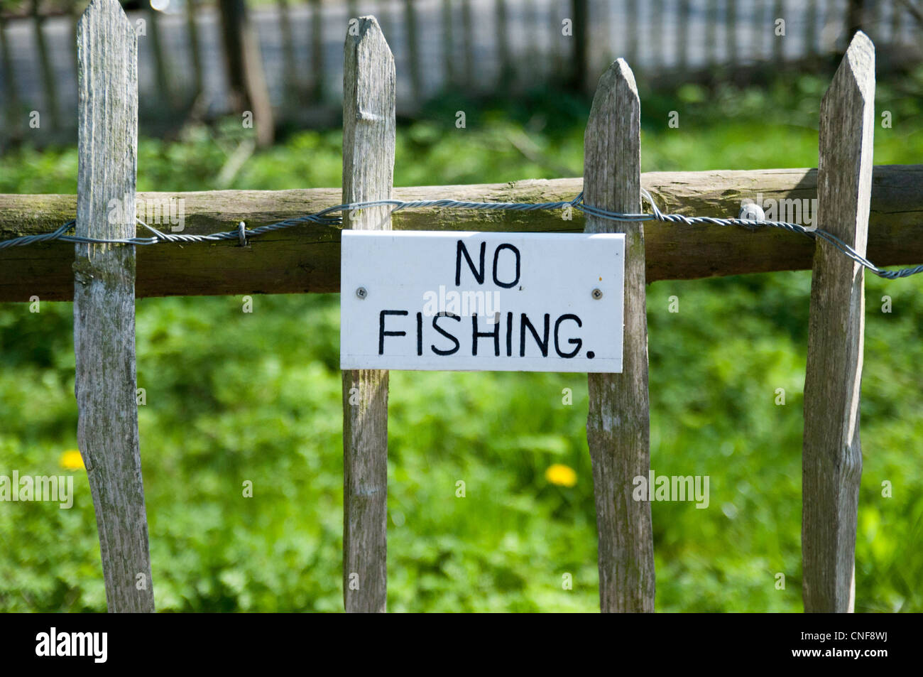 no fishing sign on towpath fence at powder mill lock - Stock Image