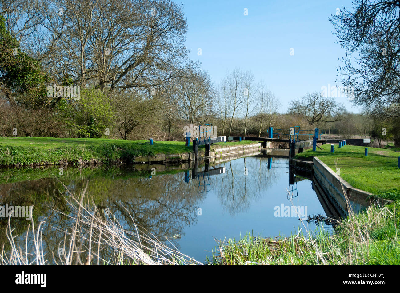 Open lock on river Chelmer with still water and reflection  of balance beam - Stock Image