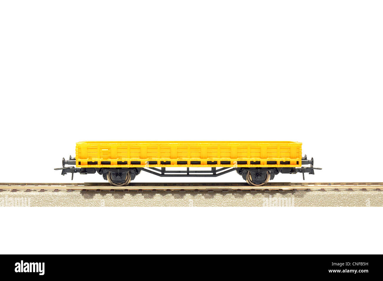 yellow cargo carriage railroad toy model, H0 scale, isolated on white with clipping path - Stock Image