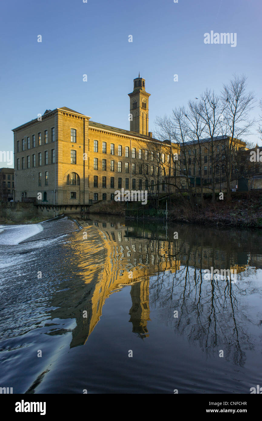 Salt's Mill reflected in the River Aire Saltaire West Yorkshire England - Stock Image