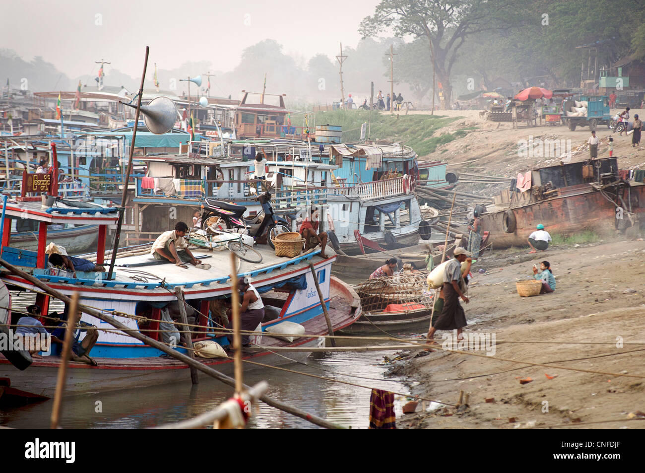 Riverside scene - boats on the waterfront, Mandalay, Burma. Irrawaddy  River, Myanmar - Stock Image