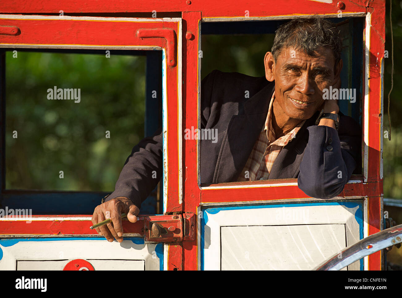 Burmese driver of local horsedrawn transport distinctive to Pyin U Lwin, Burma - a colonial relic. Myanmar. MODEL - Stock Image