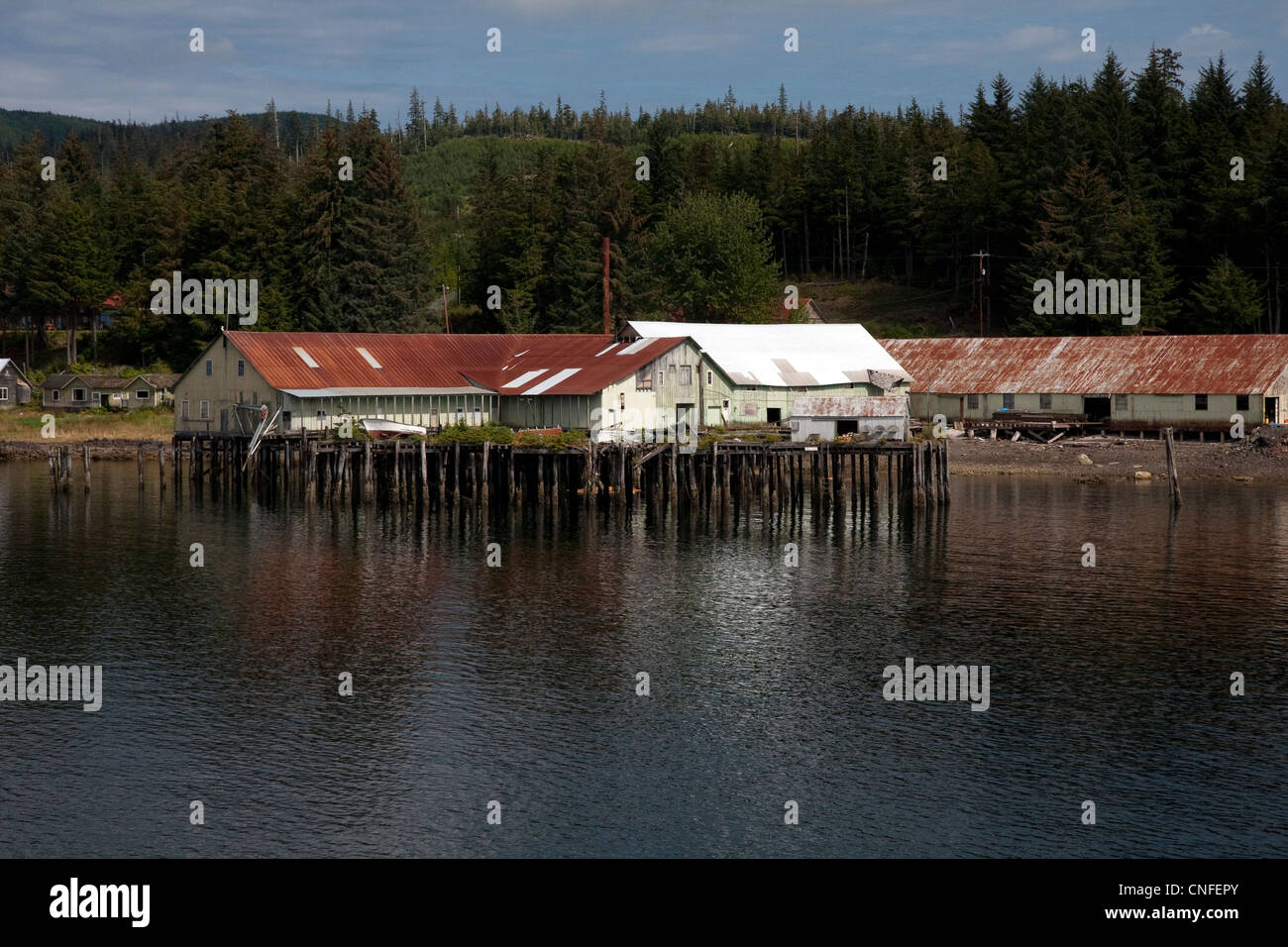 Old buildings on pilings along the inside passage near Kake, Alaska, USA - Stock Image