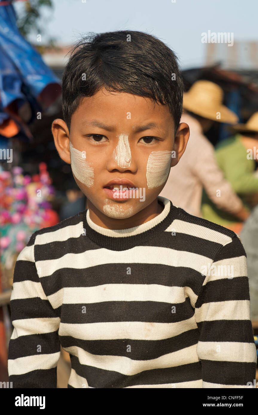Portrait of Burmese boy with painted face at Hsipaw market, Burma - Stock Image