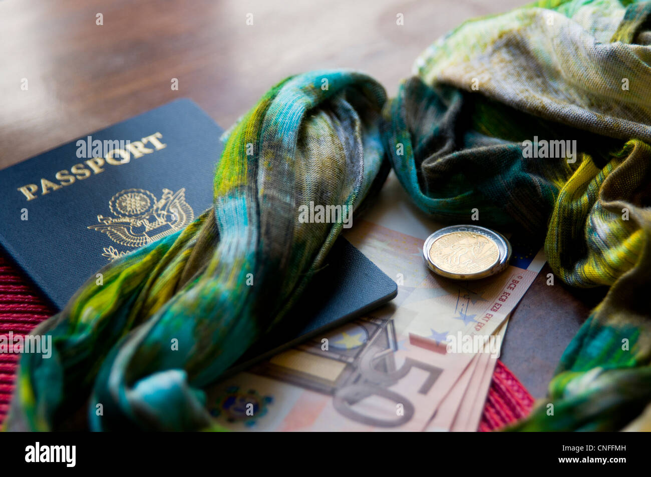 Euro dollar currency and change with travel passport - Stock Image