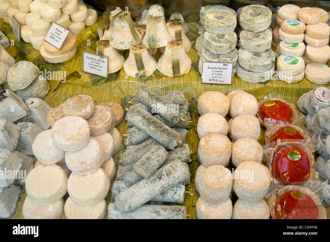 French cheese for sale at the Fromagerie on Rue Cler in Paris, France - Stock Image