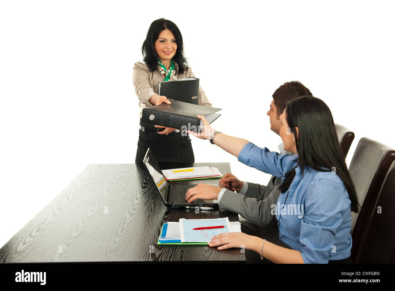 Manager woman giving folder to her employees in office Stock Photo