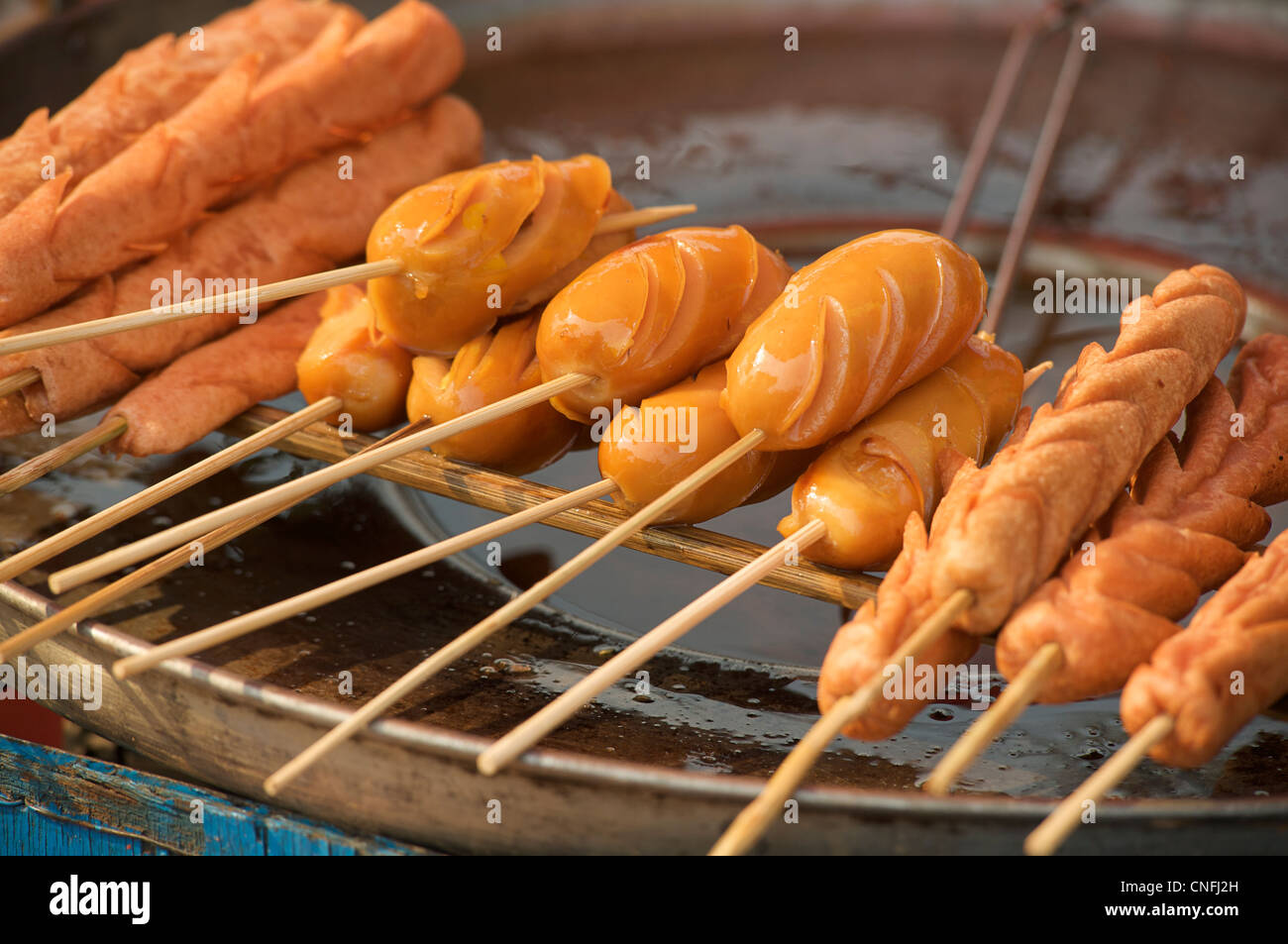fried seafood sticks for sale at market. Burma. Myanmar - Stock Image