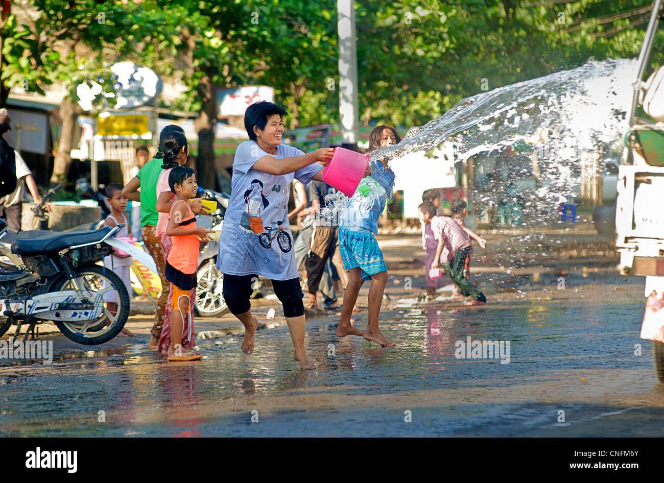 Burmese woman and children enjoying the water festival near Meikila. Burma. Myanmar - Stock Image