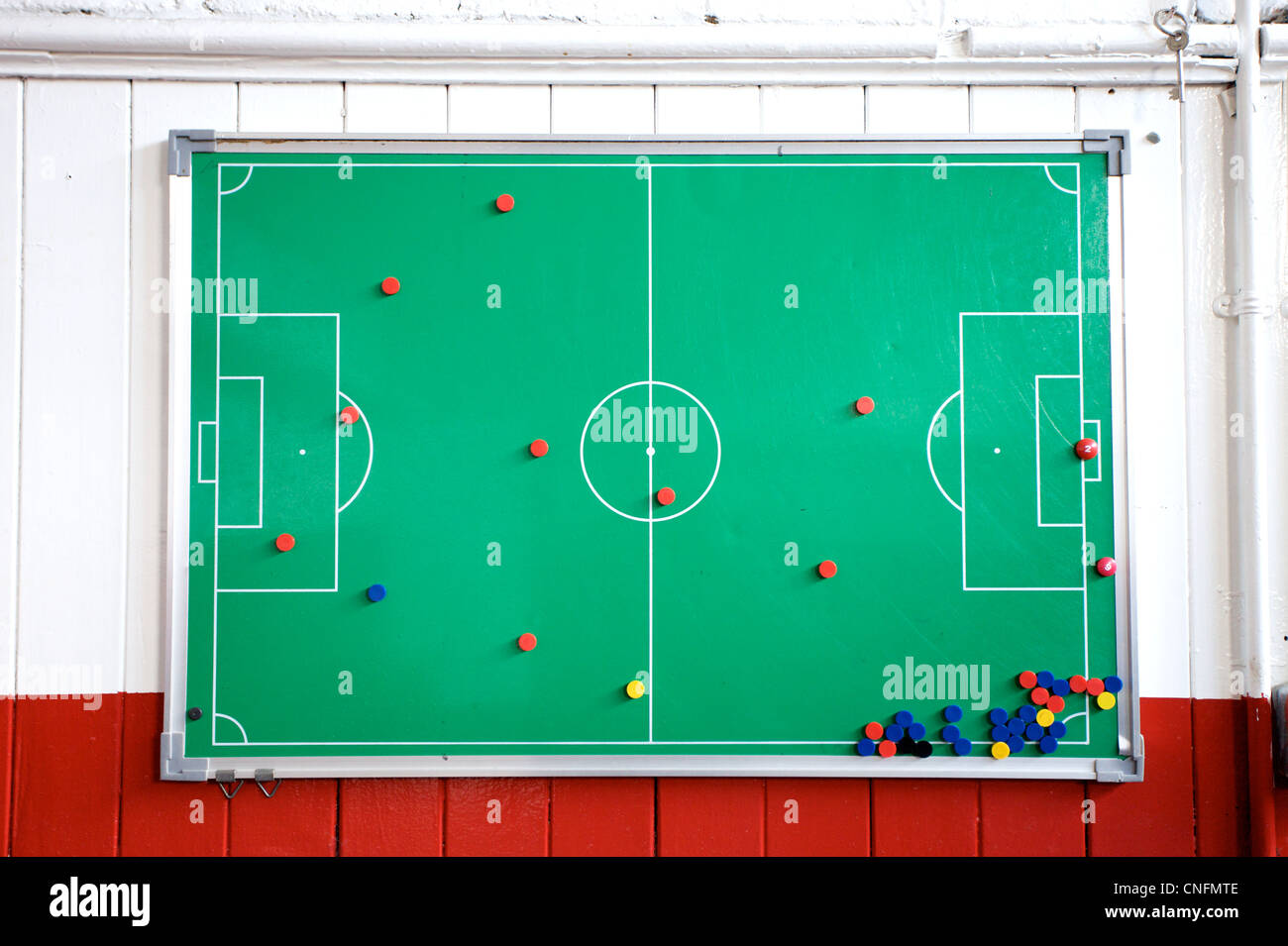 A football tactics board in the dressing room of a football stadium. - Stock Image