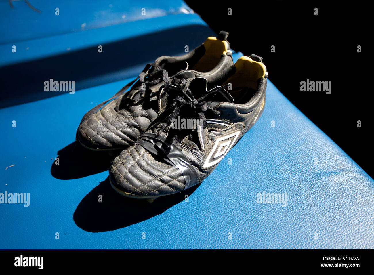 A pair of old football boots. - Stock Image