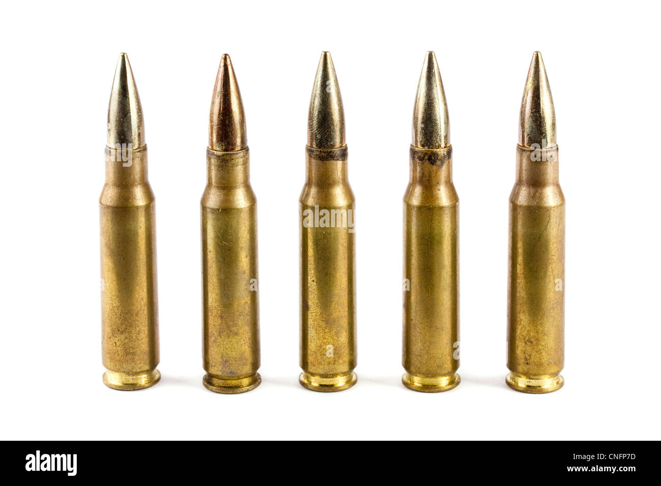 Five rifle bullets over white - Stock Image
