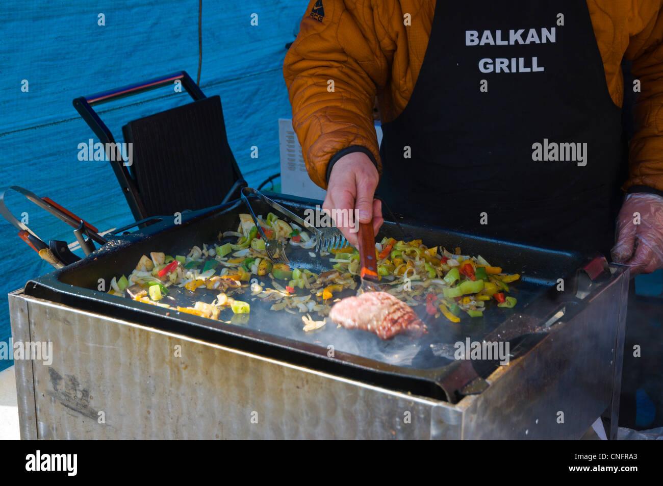 Balkan grill stall Farmarske trhy the farmers market in Jiriho z Podebrad square Vinohrady district Prague Czech - Stock Image